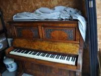 This is a circa 1900 Kilenberg upright piano marketed