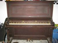 older upright piano, ivory keys all work, will need a