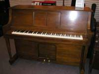 Upright roll player piano for sale at $1300. Player