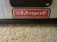 "For sale ""Royal"" upright vacuum with attachments."