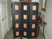 Holds 12 5x7 pictures, stands almost 6ft tall and is