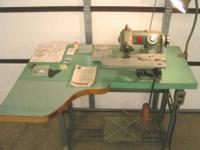 This is a commercial blind stitch machine with the