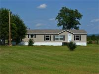 4 bed room home with 7.5 acres. House has open layout