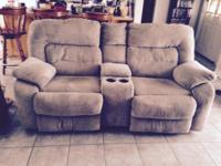 This is a tan cloth love seat. Both seats recline.