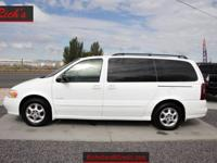 This 2003 Oldsmobile Silhouette minivan is a n