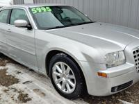 THIS IS A VERY CLEAN CHRYSLER 300 WITH ALL THE