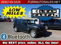 CLEAN CARFAX AND LOW MILES on this nice, clean Jeep