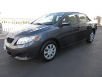 Our 2010 Toyota Corolla LE Sedan pours on the charm and