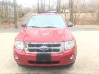 Our 2011 Ford Escape 4WD XLT with 2 DVD players.3-0L