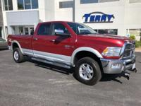 This 2012 Ram 2500 Laramie in Deep Cherry Red Crystal
