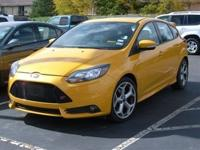 Body Style: Hatchback Exterior Color: Yellow Interior