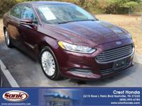 Meet the 2013 Ford Fusion Hybrid SE Sedan displayed in