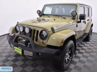 Unlimited Sahara with aftermarket wheels, bumpers,
