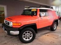Body Style: SUV Exterior Color: Orange Interior Color: