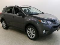 Our 2013 Toyota RAV4 Limited AWD SUV shown in dynamite