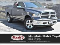 Come see this 2014 Ram 1500 Laramie. Its Automatic
