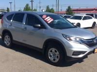 This outstanding example of a 2015 Honda CR-V LX is