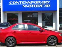2015 Mitsubishi Lancer SE Red 4WD. Odometer is 26620