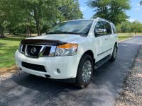 Our 2015 Nissan Armada Platinum shown in Pearl White is