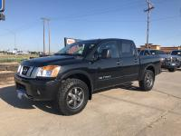 Check out this 2015 Nissan Titan PRO-4X. Its Automatic