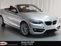 This 2016 BMW 228i has a Clean Carfax, Glacier Silver