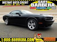 Eye-catching in Pitch Black Clear Coat, our 2016 Dodge