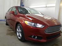 The paint has a showroom shine. This 2016 Ford Fusion