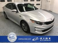 Here's a fun to drive Optima LX in Sparkling Silver w/
