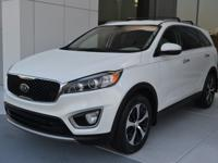 This 2016 Kia Sorento has a 2.4L Engine and is White