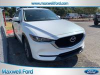 This outstanding example of a 2017 Mazda CX-5 Touring
