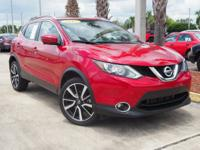 This 2017 Nissan Rogue Sport SL in Ruby features: Clean