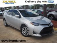 This 2017 Toyota Corolla LE in Black Sand Pearl