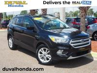 This 2018 Ford Escape SE in Shadow Black features: