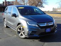 This Honda Odyssey Touring is a great pre-owned car.