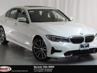 This 2019 BMW 330i has a Clean Carfax, Alpine white