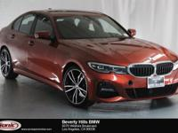 This 2019 BMW 330i has a Clean Carfax, Sunset Orange