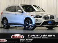 This 2019 BMW X1 xDrive has a Clean Carfax, Glacier