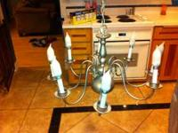 Used candlestick style chandelier. Comes with 8 used
