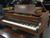 "This medium mahogany Chickering (6'5"") Grand Piano"