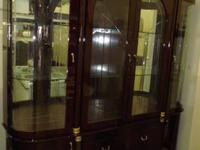 Used Dark Reddish Brown China Hutch has 3 Glass Doors