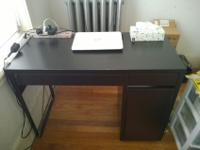 Newly purchased two years ago, an IKEA desk is