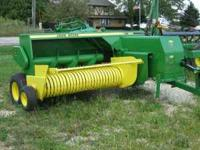 This is a used 1990 John Deere 328 square baler with 40