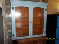 used kitchen furniture cabinet with glass doors in good