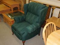 Used green fabric Lane wingback high leg recliner.