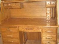 Used solid oak roll top desk. Execellent condition. Has