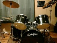 Used 5 piece OrbiTone Drumset. Black in color. New
