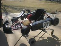 I Have an older gold track Race Kart with lots of extra
