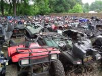Large inventory of salvage ATVs and used parts for