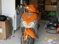 2012 150cc scooter for sale. Color is Orange and Black.
