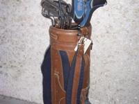 USED SET OF MEN'S KING COBRA'S GOLF CLUBS. 3 WOODS, 8